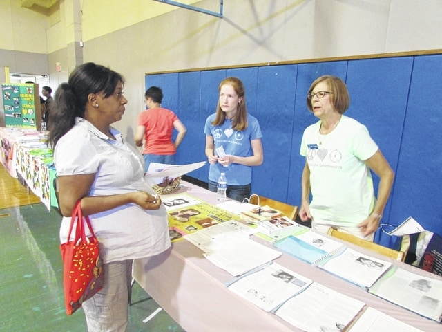 Danae King | The Lima News Meghan Moniaci and Debbie Schymanski talk to an expectant mother about La Leche League of Lima, a breast-feeding support group, at the Community Baby Shower on Saturday.