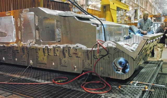 A General Dynamics Land Systems employee welds while working on a new aluminum chassis in 2012 for a vehicle being built at the Joint Systems Manufacturing Center in Lima. The facility produces about one tank a month right now but expects to see an uptick in work in the coming months.