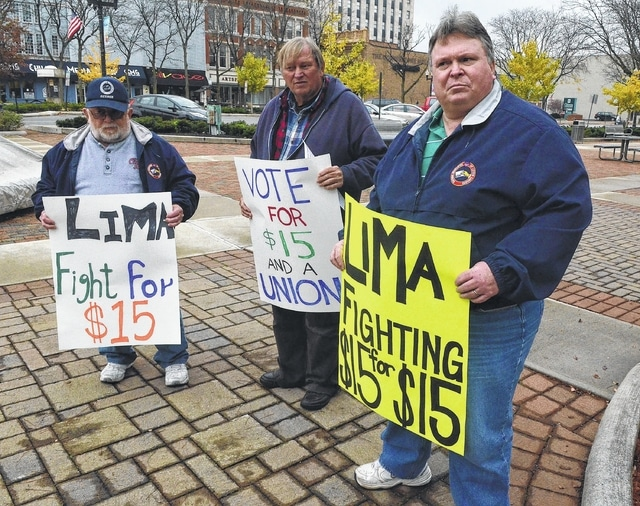 Craig J. Orosz   The Lima News Jim Wilhelm, Fred Brinkman and Tom McNamara, far right, participate in a solidarity protest outside Lima City Hall on Tuesday, pushing for $15 an hour as the new federal minimum wage.