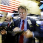 US stocks end a bumpy day slightly lower