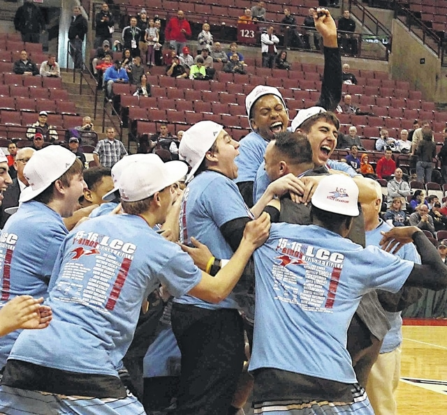 Members of Lima Central Catholic's boys basketball team hug coach Frank Kill after winning the Division III state championship at Value City Arena in Columbus on March 19. Each of the regular seven players had a key role in making the Thunderbirds' season a success in 2015-16.