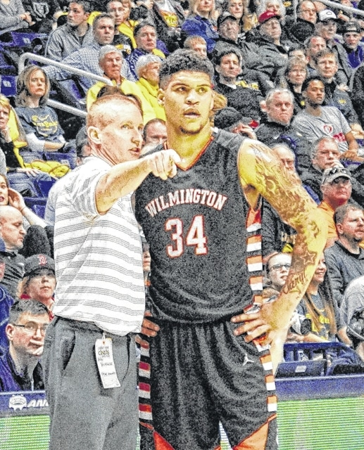 """Wilmington coach Michael Noszka, left, talks with senior forward Jarron Cumberland, 34, during the Division I regional finals at Xavier University's Cintas Center. Lima Senior coach Quincey Simpson, who coached Cumberland on an AAU team, called the a 6-5 senior forward """"the best scorer in the state."""""""
