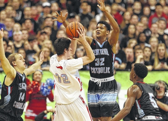 Lima Central Catholic's Nick Taflinger (14), Dantez Walton (32) and Tre Cobbs apply pressure to Cleveland Villa Angela-St. Joseph's Danny McGarry during Saturday's Division III state championship game Saturday at Value City Arena in Columbus.