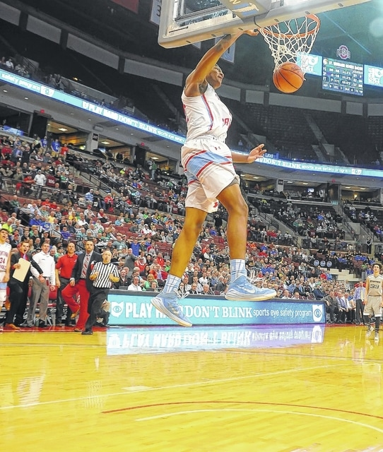 Lima Central Catholic's Dantez Walton dunks against Roger Bacon during a Division III state semifinal Thursday at Value City Arena in Columbus.