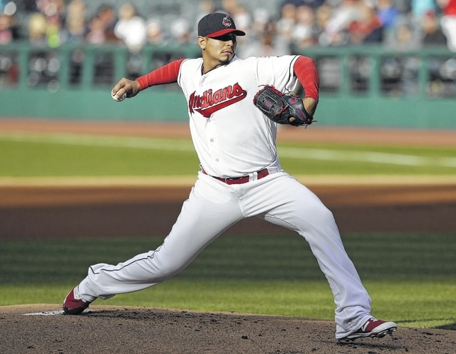 Indians starting pitcher Carlos Carrasco delivers during Tuesday night's game against Seattle in Cleveland.
