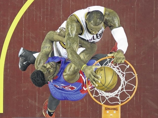 The Cavaliers' LeBron James dunks the ball against Detroit's Reggie Bullock during Wednesday night's first-round playoff game in Cleveland.