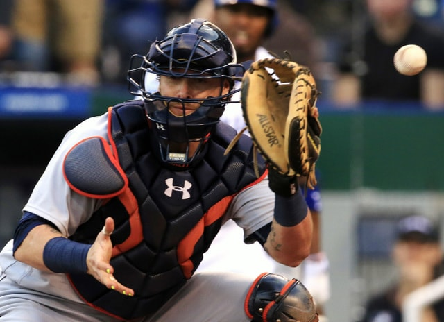 The ball gets past Detroit Tigers catcher Jarrod Saltalamacchia allowing Kansas City Royals' Kendrys Morales to score without a play during the second inning of a baseball game at Kauffman Stadium in Kansas City, Mo., Tuesday, April 19, 2016. (AP Photo/Orlin Wagner)