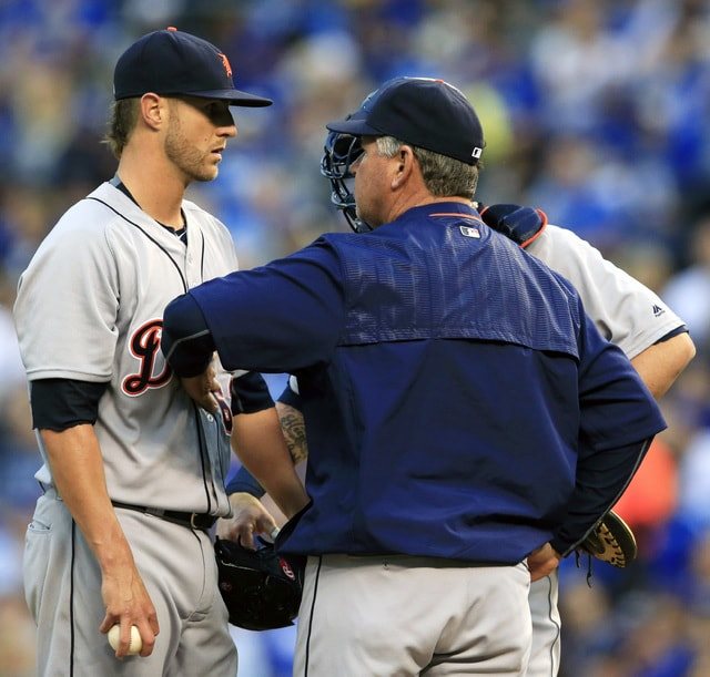 Detroit Tigers starting pitcher Shane Greene, left, talks with pitching coach Rich Dubee and catcher Jarrod Saltalamacchia, back, during the third inning of a baseball game against the Kansas City Royals at Kauffman Stadium in Kansas City, Mo., Tuesday, April 19, 2016. (AP Photo/Orlin Wagner)