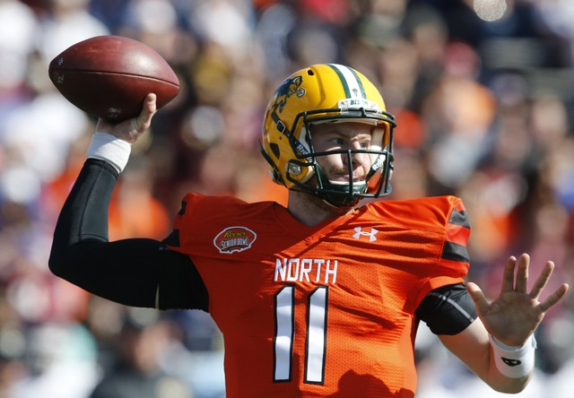 FILE - In this Jan. 30, 2016, file photo, North Dakota State quarterback Carson Wentz throws a pass during the Senior Bowl NCAA college football game at LaddPeebles Stadium, in Mobile, Ala. The Philadelphia Eagles acquired the No. 2 overall pick in next week's draft from the Cleveland Browns in exchange for five picks on Wednesday, April 20, 2016. The trade allows Philadelphia to select one of the top quarterback prospects, Carson Wentz of North Dakota State or Jared Goff of California at No. 2. (AP Photo/Brynn Anderson, File)