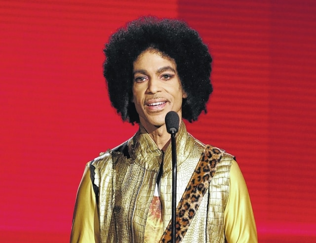 Prince presents the award for favorite album-soul/R&B at the American Music Awards in Los Angeles on Nov. 22, 2015.