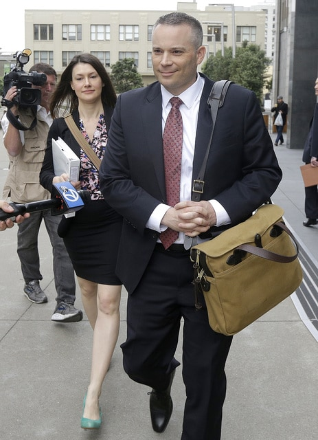 Joshua Van Eaton, an attorney with the Department of Justice, leaves the Phillip Burton Federal Building after a court hearing, in San Francisco, Thursday, April 21, 2016. An agreement will give consumers who bought nearly 600,000 Volkswagen vehicles rigged to cheat on emissions tests the option of having the automaker buy back the cars or fix them, a judge said Thursday. (AP Photo/Jeff Chiu)