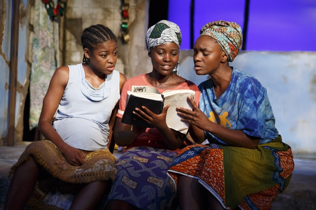 "This photo provided by The Public Theater shows, from left, Pascale Armand, Lupita Nyongo and Saycon Sengbloh in ""Eclipsed,"" written by Danai Gurira. In an effort to shine a light on the hundreds of girls abducted from a school in Nigeria two years ago, all performances of the Broadway play will be dedicated to the still-missing victims. Gurira said Friday that each future performance of her play will be dedicated to a girl who has been abducted by the Boko Haram and will be named in her honor."