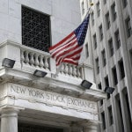 Stock indexes end mixed as investors size up earnings
