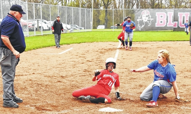 Bluffton's Ameri Siferd slides home covered by Crestview pitcher Jada Preston ahead of the throw during Thursday's game in Bluffton.