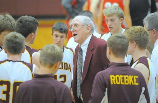 Kalida basketball coach Richard Kortokrax addresses his team during a 2012 basketball game.