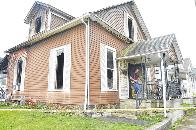 Sidney Firefighters were still on the scene of a house fire at 8:30 a.m. Thursday, April 21. The house is located at the intersection of Pomeroy Avenue and North Street. Luke Gronneberg | Sidney Daily News