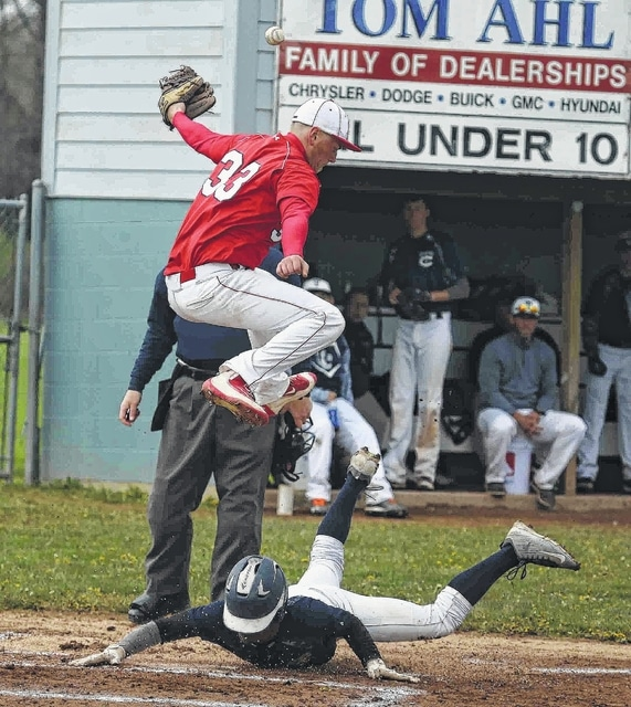 Temple Christian's Adrian Williams slides safe into home plate as Perry's Sam Sanders tries to handle the throw during Saturday's doubleheader at Temple Christian.