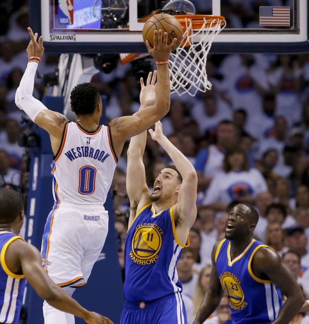 ab7955308dd Oklahoma City Thunder guard Russell Westbrook (0) shoots over Golden State  Warriors guard Klay