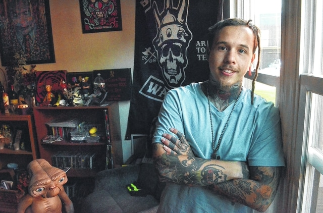 Former heroin user Charlie Oen at home in Lima. Oen believes music played a part during his recovery from drugs.