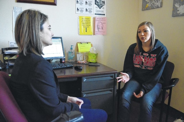 Ashley Hinkle, a counselor for Coleman Behavioral Health in Lima, talks with recovering addict, Kylie Craft, of Lima.