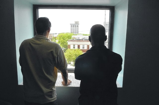 Michael Evans, left, and Reggie Gant look over the Lima skyline, reflecting on their addictions to pain medication that led to heroin addictions.