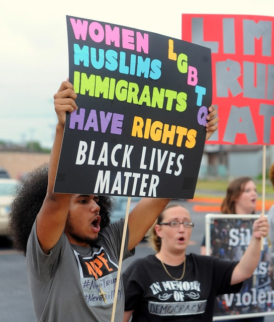 Ceyshon Huggins, 16, of Lima, protests with his mother, Erin Dunson, of Lima. Richard Parrish | The Lima News