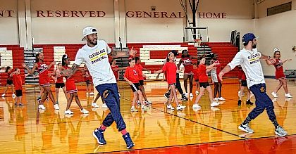 """Members of the Cleveland Cavaliers' """"Scream Team"""" perform a dance routine with cheerleaders at Perry schools on Sunday. The visit was made possible by Perry graduate Emily Smith, who works for the Cavaliers organization."""