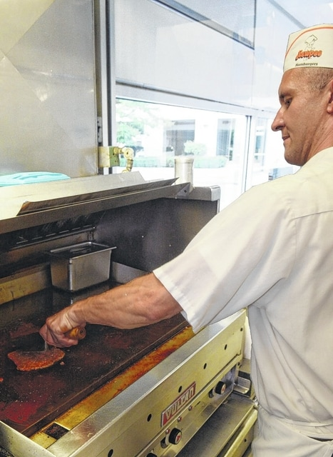 Neil Koenig cooks a burger at the downtown Kewpee.