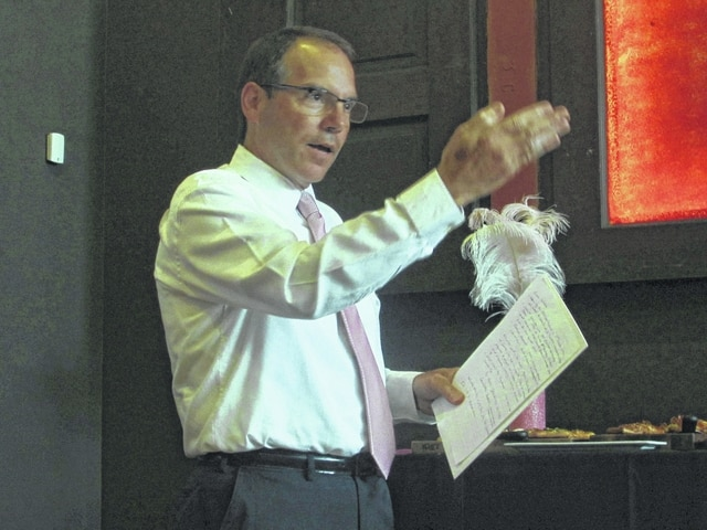 Andy Farley gives an overview of the American Cancer Society's first annual Real Men Wear Pink campaign Thursday at The Met in Lima.