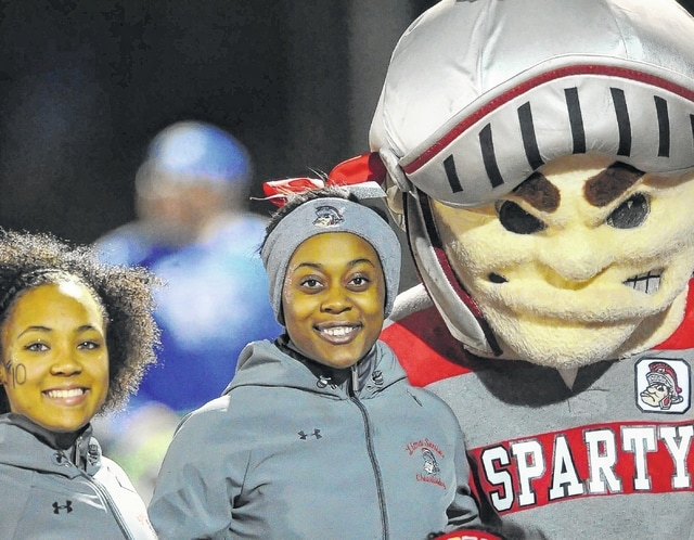 Lima Senior cheerleaders cozy up with Sparty.
