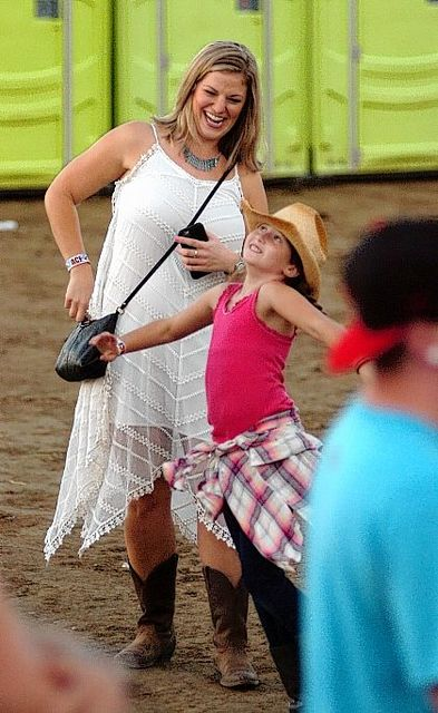 Mary Wiechart and her niece Norah Welly, 9, dance together Saturday during the Kelsea Ballerini and Rascal Flatts concert at the Allen County Fair in Lima.