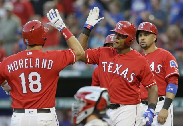 Texas Rangers' Mitch Moreland (18) celebrates his grand slam with teammate Adrian Beltre, right, as Rougned Odor, back, and Carlos Beltran look on after they all scored during the first inning of a baseball game against the Cleveland Indians in Arlington, Texas, Saturday, Aug. 27, 2016. (AP Photo/LM Otero)