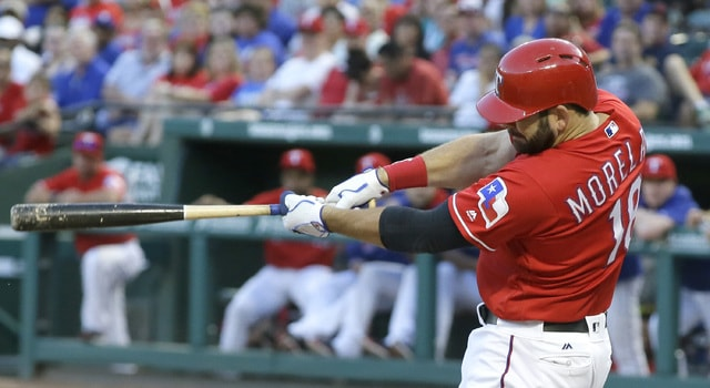 Texas Rangers' Mitch Moreland swings through his grand slam during the first inning of a baseball game against the Cleveland Indians in Arlington, Texas, Saturday, Aug. 27, 2016. (AP Photo/LM Otero)