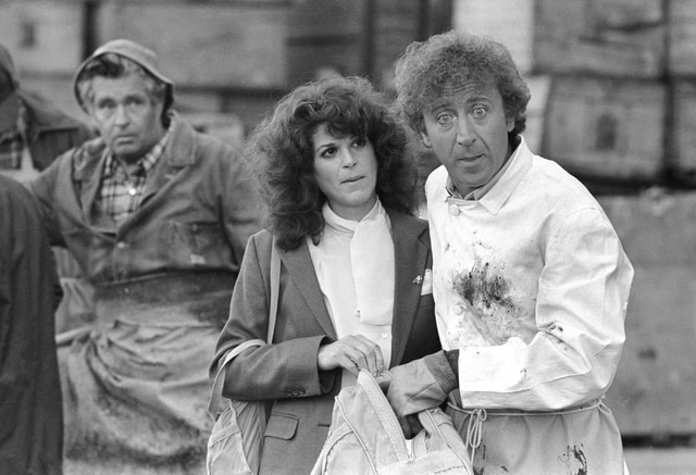 """In this Aug. 27, 1981, file photo, Gilda Radner, center, and Gene Wilder, right, perform in a scene from the film """"Hanky Panky,"""" directed by Sidney Poitier in Boston. Wilder's nephew said Monday that the actor and writer died late Sunday at his home in Stamford, Conn., from complications from Alzheimer's disease. He was 83."""