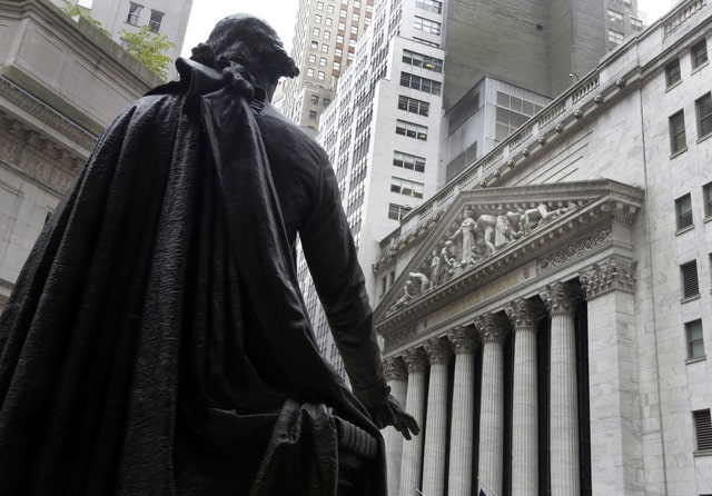 FILE - In this Oct. 2, 2014, file photo, the statue of George Washington on the steps of Federal Hall faces the facade of the New York Stock Exchange. Stocks are opening moderately higher on Wall Street, Monday, Aug. 29, 2016, as the market comes off three days of losses. (AP Photo/Richard Drew, File)