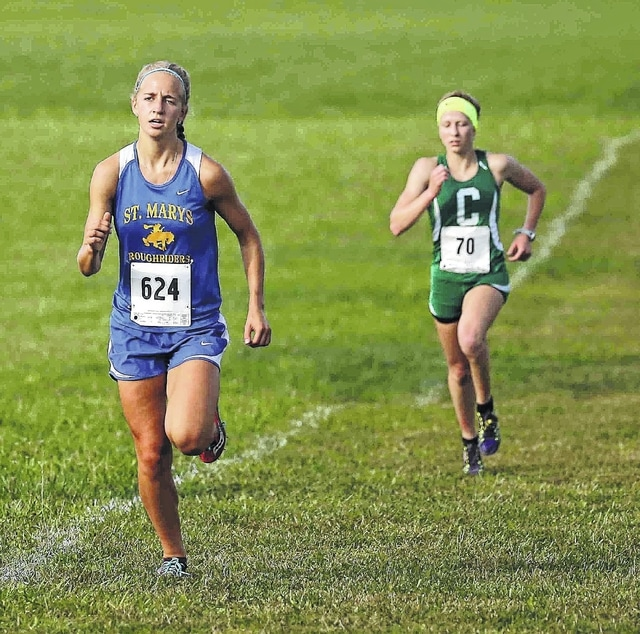 St. Marys' Kelly Wilker leads Celina's Lauren McDonough during the Division I-II race Saturday at the Celina Rotary Cross Country Invitational at the Wright State University – Lake Campus.