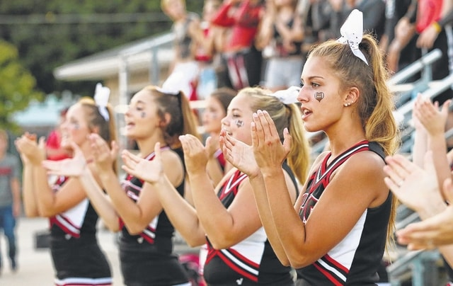 The Shawnee cheerleaders root on the Indians during Saturday night's game in Delphos.