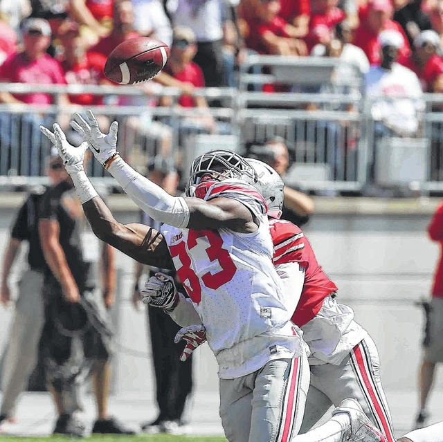 Sophomore wide receiver Terry McLaurin (83) makes a catch during Ohio State's spring game. He is one of many young players hoping to break into the lineup at OSU this season. DON SPECK/The Lima News