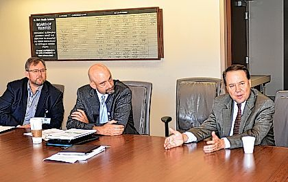 U.S. Rep. Pat Tiberi, R-Worthington, far right, discusses the health care industry with officials from St. Rita's Medical Center, the city of Lima and fellow politicians. St. Rita's Health Partners President/CEO Bob Baxter, center, and St. Rita's President Dale Gisi, left, look on.