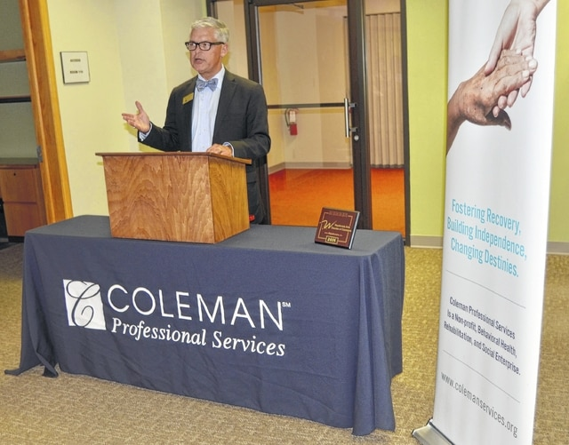 Nelson Burns, president/CEO of Coleman Professional Services, speaks Thursday at a ribbon-cutting ceremony for the organization's newest office in downtown Wapakoneta.