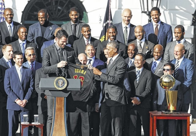 e2dcb24695f President Barack Obama accepts a team basketball jersey from the Cleveland  Cavaliers' team members Kevin