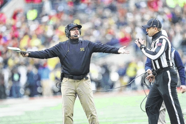 Michigan Head coach Jim Harbaugh pleads his case to an officials after receiving an unsportsmanlike conduct penalty during Saturday's game at Ohio Stadium in Columbus.