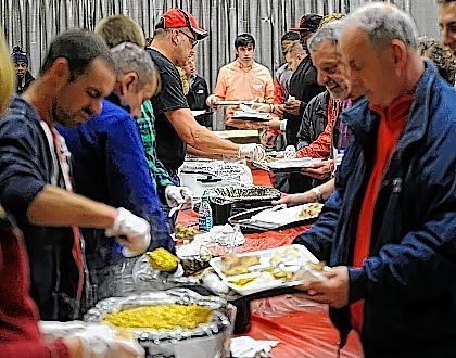 Volunteers served food during Thursday's Lewis Family McDonalds Thanksgiving Day Dinner held at the Lima Veterans Memorial Civic and Convention Center. Richard Parrish | The Lima News
