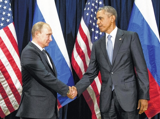 FILE - In this Sept. 28, 2015 file photo, President Barack Obama shakes hands with Russian President President Vladimir Putin before a bilateral meeting at United Nations headquarters. Obama has ordered intelligence officials to conduct a broad review on the election-season hacking that rattled the presidential campaign and raised new concerns about foreign meddling in U.S. elections, a White House official said Friday. White House counterterrorism and Homeland Security adviser Lisa Monaco said Obama ordered officials to report on the hacking of Democratic officials' email accounts and Russia's involvement.