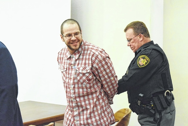 Ross McWay looks back at his family with a smile Friday after a jury acquitted him of two counts of rape over a March 23 incident involving a woman he met a bar. The jury could not decide on a kidnapping charge, which the prosecution has to decide whether to retry.