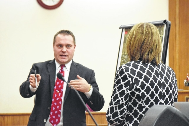 Lima Police Detc. Steve Stechschulte testifies before the jury Thursday at the rape trial of Ross McWay, explaining to the prosecutor various locations on a Lima map relevant to the case.