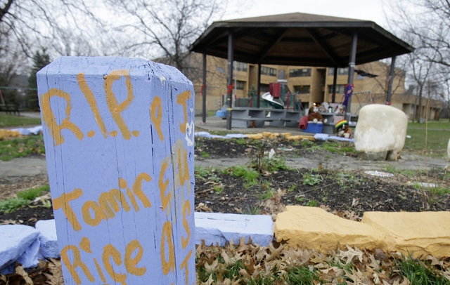"""In this Dec. 29, 2015, file photo, """"R.I.P. Tamir Rice"""" is written on a wooden post near a makeshift memorial at the gazebo where a white patrol officer fatally shot the boy on Nov. 22, 2014, outside the Cudell Recreation Center in Cleveland. A disciplinary hearing for 911 dispatcher Constance Hollinger took place Friday with Hollinger facing possible suspension for up to 10 days on internal disciplinary charges for what the city said was her failure to pass on relevant information to another dispatcher."""