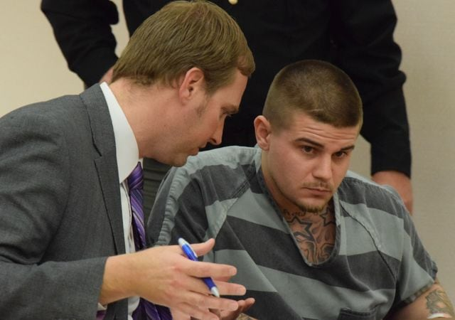 Richard Stoneburner listens to his attorney, Zach Maisch, during a hearing Tuesday in which he is trying to get a statement he made to investigators excluded from evidence.