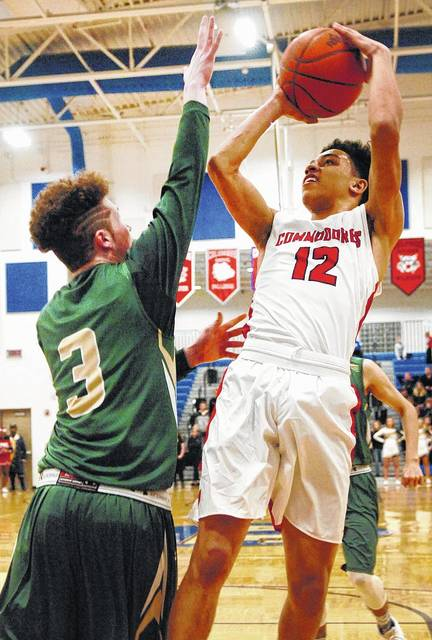 Perry's Jamal Whiteside puts up a shot against Ridgemont's Trevor Stover during a Friday night Division IV sectional final at Allen East.