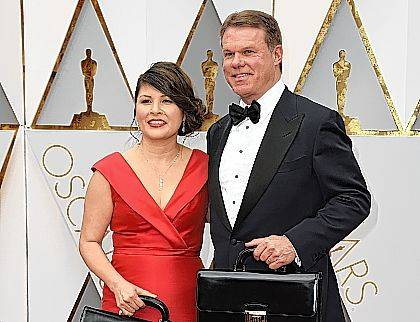 This Sunday file photo shows Martha L. Ruiz, left, and Brian Cullinan from PricewaterhouseCoopers at the Oscars in Los Angeles. Film academy president Cheryl Boone Isaacs says the two accountants responsible for the best picture mistake will not work the Oscars again. Cullinan and Ruiz were responsible for the winners' envelopes at Sunday's Oscar show. Cullinan tweeted a photo of Emma Stone from backstage minutes before handing presenters Warren Beatty and Faye Dunaway the wrong envelope for best picture. Boone Isaacs said Cullinan's distraction caused the error.